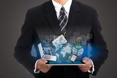 Businessman holding touch pad Stock Photos