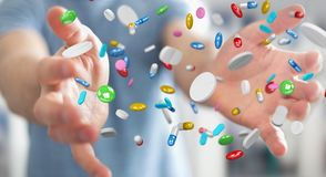 Businessman holding and touching floating medicine pills 3D rend Royalty Free Stock Images
