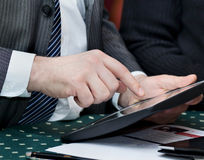 Businessman holding touchpad pc Royalty Free Stock Photos