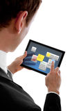 Businessman holding a touchpad pc using widgets Royalty Free Stock Photography