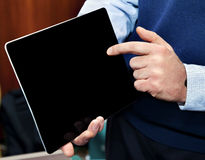 Businessman holding touchscreen pc Royalty Free Stock Images