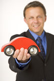 Businessman Holding A Toy Car Stock Photography