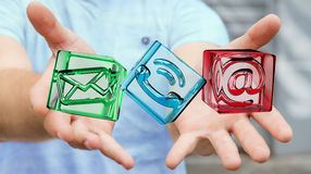Businessman holding transparent cube contact icon in his hand 3D Stock Photography