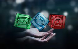 Businessman holding transparent cube contact icon in his hand 3D. Businessman on blurred background holding transparent cube contact icon in his hand 3D Stock Photo