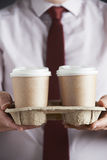 Businessman Holding Tray Of Takeaway Coffee Stock Image