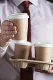 Businessman Holding Tray Of Takeaway Coffee Royalty Free Stock Image