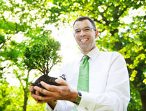 Businessman Holding Tree Plant Forest Concept Stock Photo