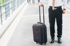Businessman holding trolley bag going up on travel.  Royalty Free Stock Photos