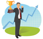 Businessman holding trophy Royalty Free Stock Image