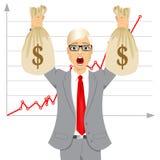 businessman holding two big dollar money bags Stock Photo