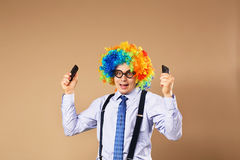 Businessman holding two mobile phones. Stock Images