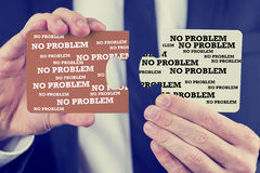 Businessman holding two puzzle pieces Royalty Free Stock Photo