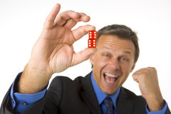 Businessman Holding Two Red Dice Royalty Free Stock Photography