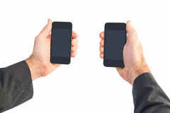Businessman holding two smart phones Royalty Free Stock Image