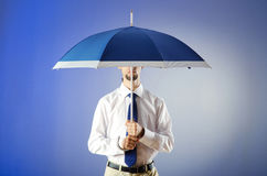 Businessman holding umbrella Royalty Free Stock Photography