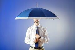 Businessman holding umbrella Royalty Free Stock Photography