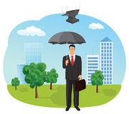 Businessman holding an umbrella Stock Photography