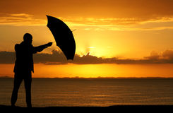 Businessman Holding Umbrella Stock Image