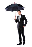 Businessman holding umbrella Royalty Free Stock Images