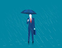 Businessman holding an umbrella. Man standing in rain. Heavy rai Stock Images
