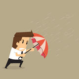 Businessman holding an umbrella in the middle of a rainstorm Stock Images