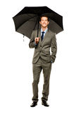 Businessman holding umbrella smiling isolated white background Royalty Free Stock Image
