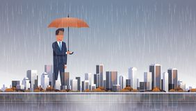 Businessman holding umbrella at storm huge rain business protection concept over big modern city building skyscraper. Cityscape background flat horizontal royalty free illustration