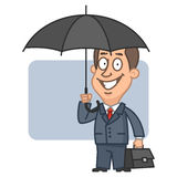 Businessman holding an umbrella and suitcase Stock Photo