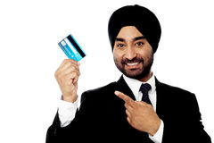 Businessman holding up credit card Stock Photo