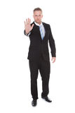 Businessman holding up his hand in a stop gesture Royalty Free Stock Photography