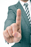 Businessman holding up his index finger. A businessman wearing a suit holding up his index finger Royalty Free Stock Photography
