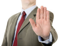Businessman holding up stop palm hand gesture. A businessman holding up stop palm hand gesture royalty free stock image