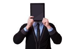 Businessman holding up a tablet pc in front of his face Royalty Free Stock Photography