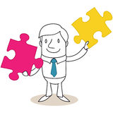 Businessman holding up two jigsaw puzzle pieces Royalty Free Stock Photo