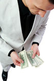Businessman holding US dollars Stock Image