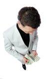 Businessman holding US dollars Royalty Free Stock Photo