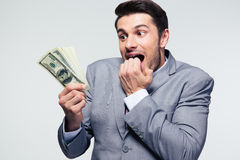 Businessman holding US dollars Royalty Free Stock Image