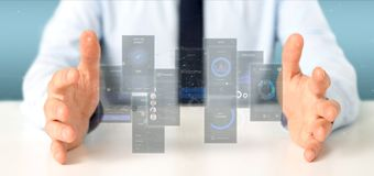 Businessman holding User interface screens with icon, stats and data 3d rendering. View of Businessman holding User interface screens with icon, stats and data stock image