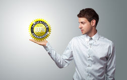Businessman holding virtual business sign Stock Image