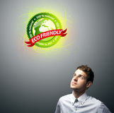 Businessman holding virtual eco sign Stock Images
