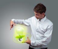 Businessman holding virtual eco sign Stock Photo