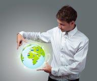 Businessman holding virtual eco sign Royalty Free Stock Photos