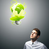 Businessman holding virtual eco sign Stock Photos