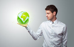 Businessman holding virtual eco sign Royalty Free Stock Photos