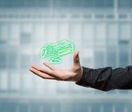 Businessman holding a virtual money Stock Image