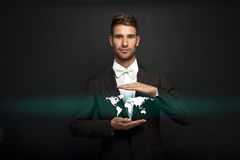 Businessman holding virtual world map Royalty Free Stock Image