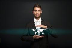 Businessman holding virtual world map Royalty Free Stock Image