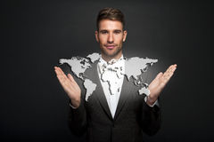 Businessman holding virtual world map Royalty Free Stock Photography