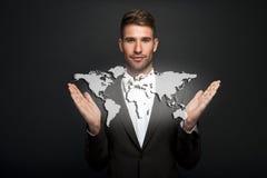 Businessman holding virtual world map Royalty Free Stock Photography