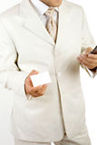 Businessman holding visit card isolated Royalty Free Stock Images